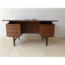 Danish Teak Desk with in built library and 6 drawer envelope hand pulls at the front.